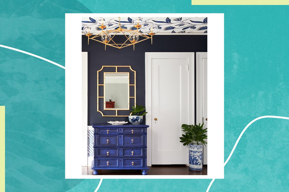 a blue entryway features a blue chest of drawers designed by Noel Gatts