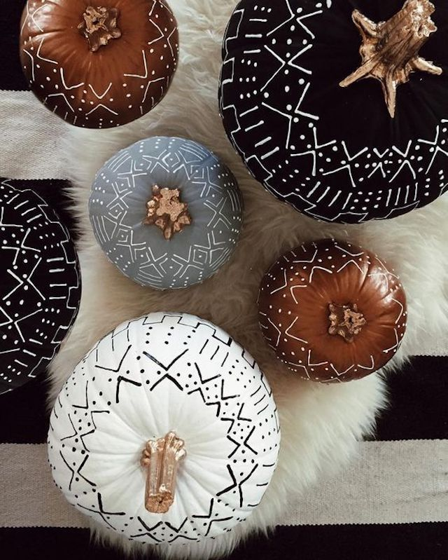 Pumpkins with chalky finish and metallic paint on them