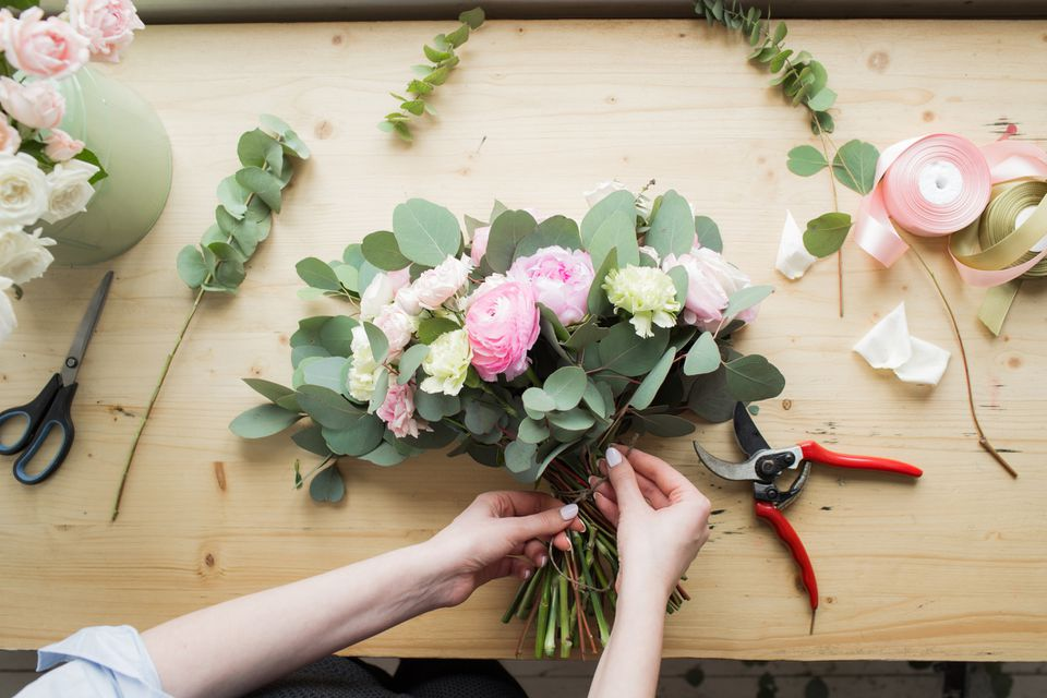 Florist arranging wedding bouquet