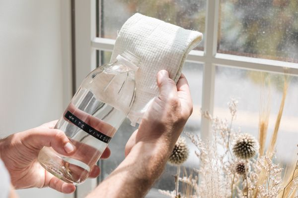 cleaning a window for good feng shui
