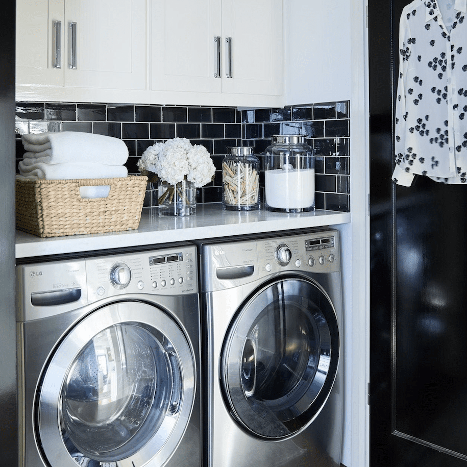 Black subway tile in laundry room