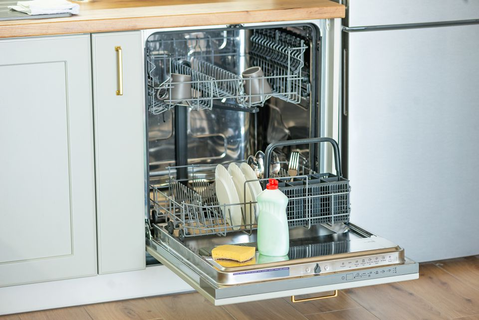 preparing to clean a dishwasher