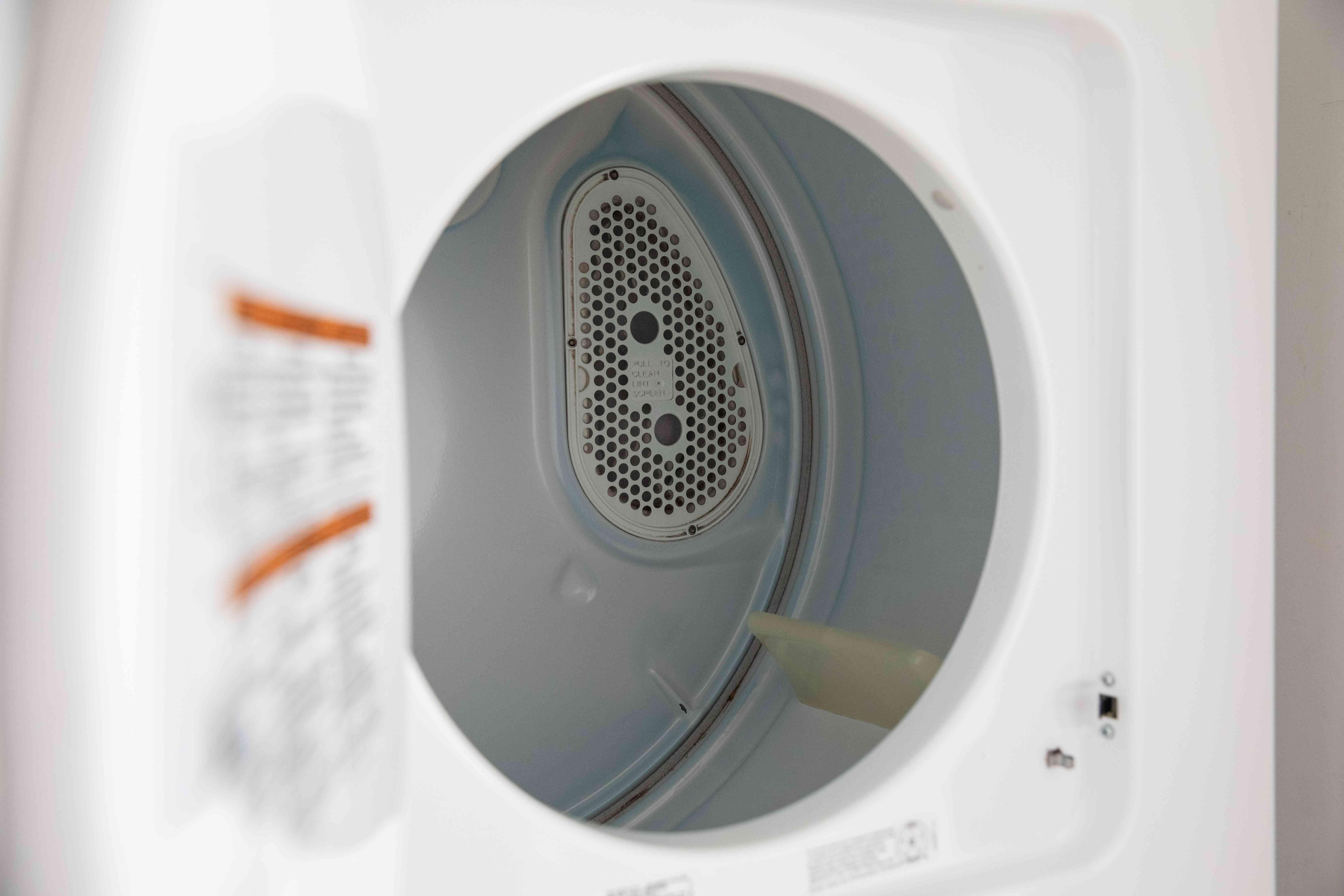 Whirlpool dryer door open revealing drum inside