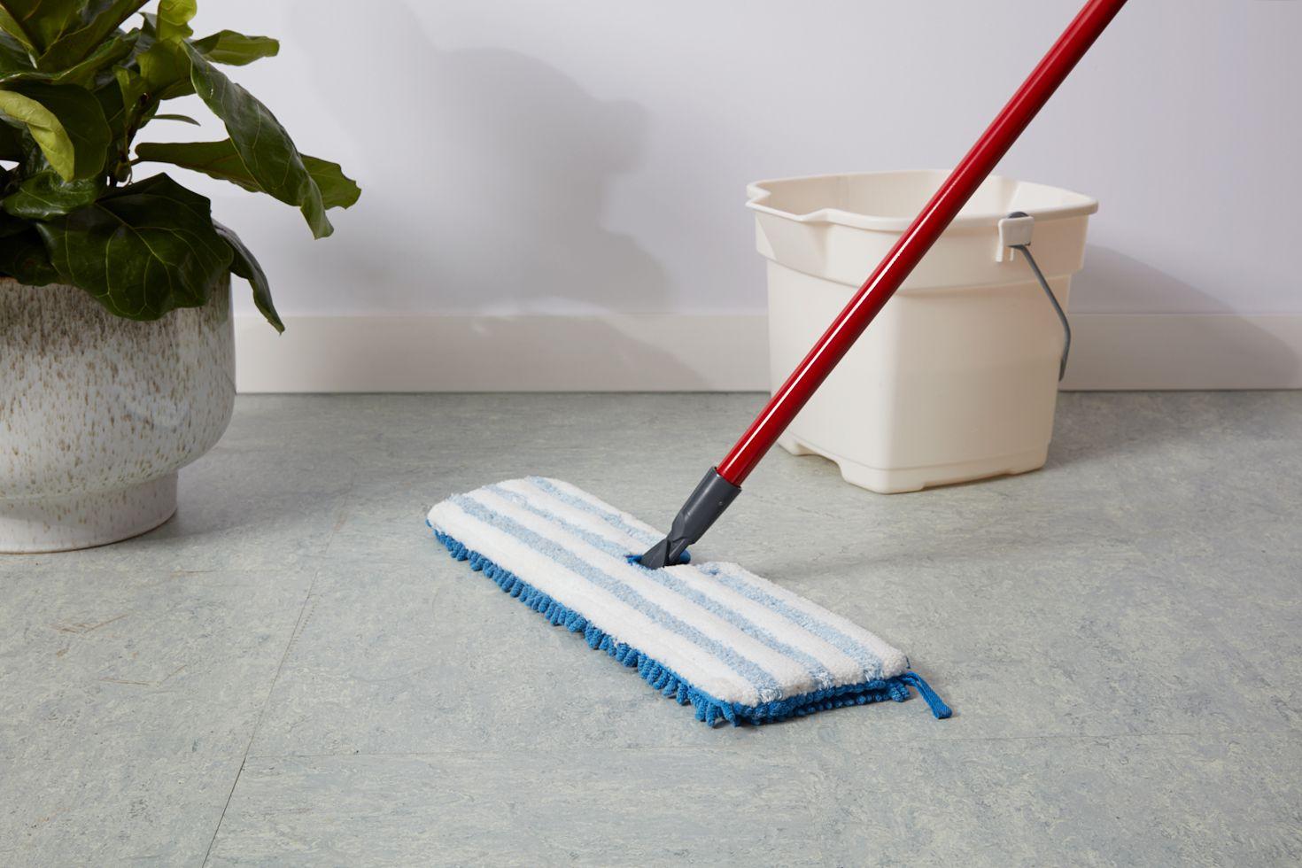 Microfiber mop on linoleum floor