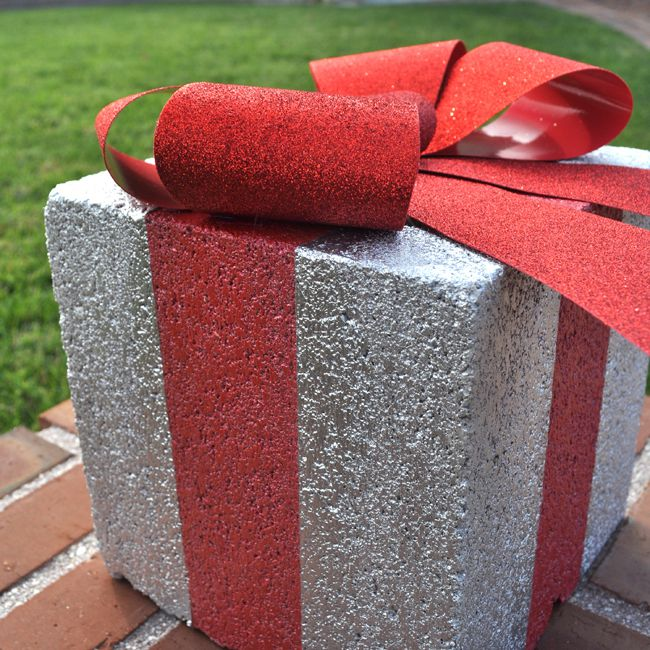 A concrete block painted with a bow