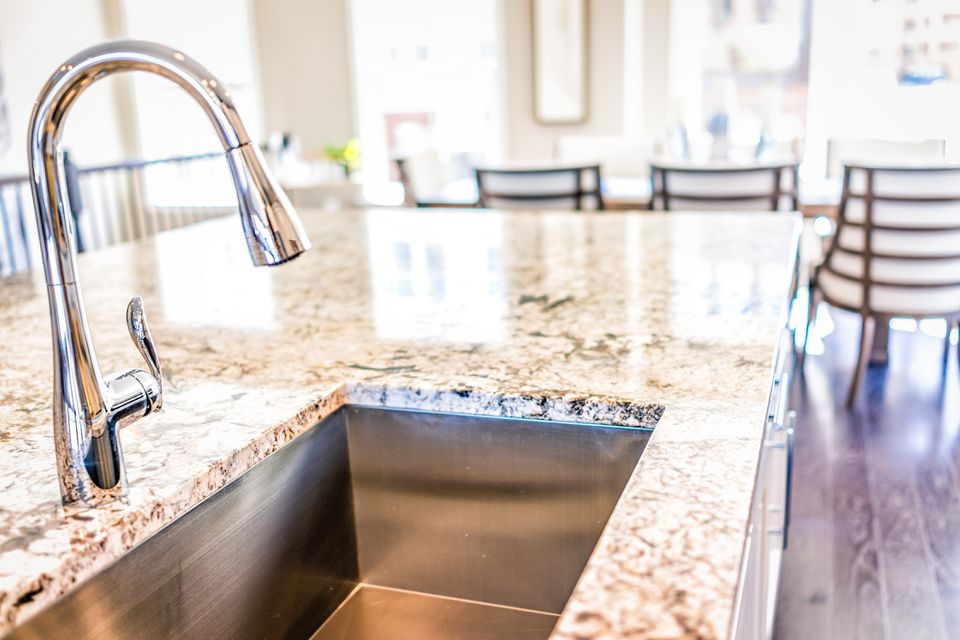 Modern kitchen sink and faucet in granite countertop