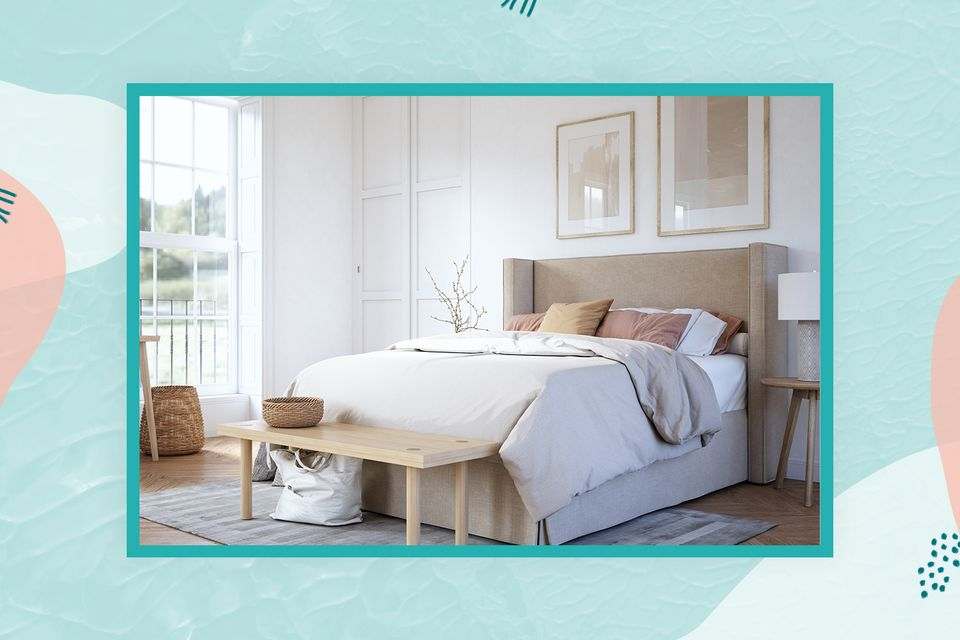 a neutral bedroom features an upholstered headboard and a bench at the foot of the bed