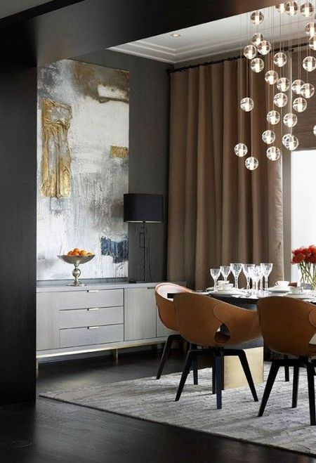 Gray Dining Room With Modern Art And Lighting