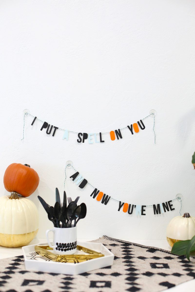 Black and orange garland on a wall