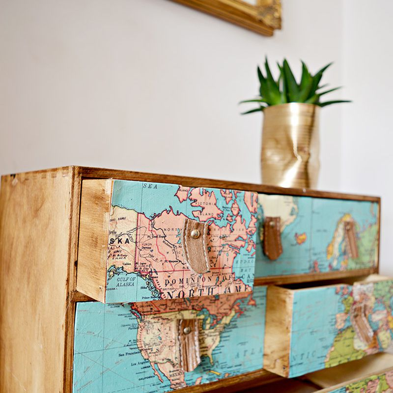 drawer dresser covered with map squares and leather pulls