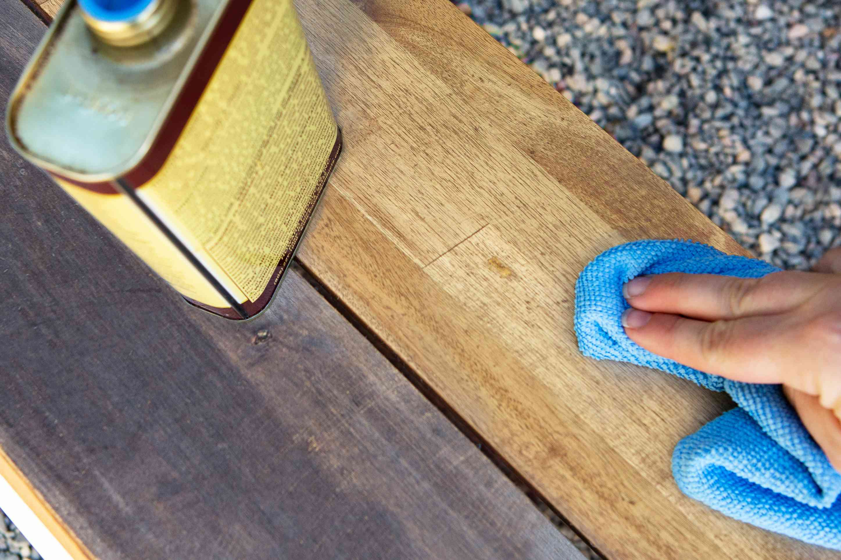 applying the wood protector with a cloth