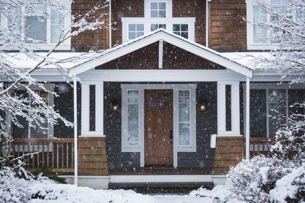 Snow falling near house