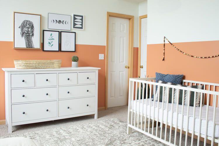 Gender-neutral room with earthy terracotta orange color palette.