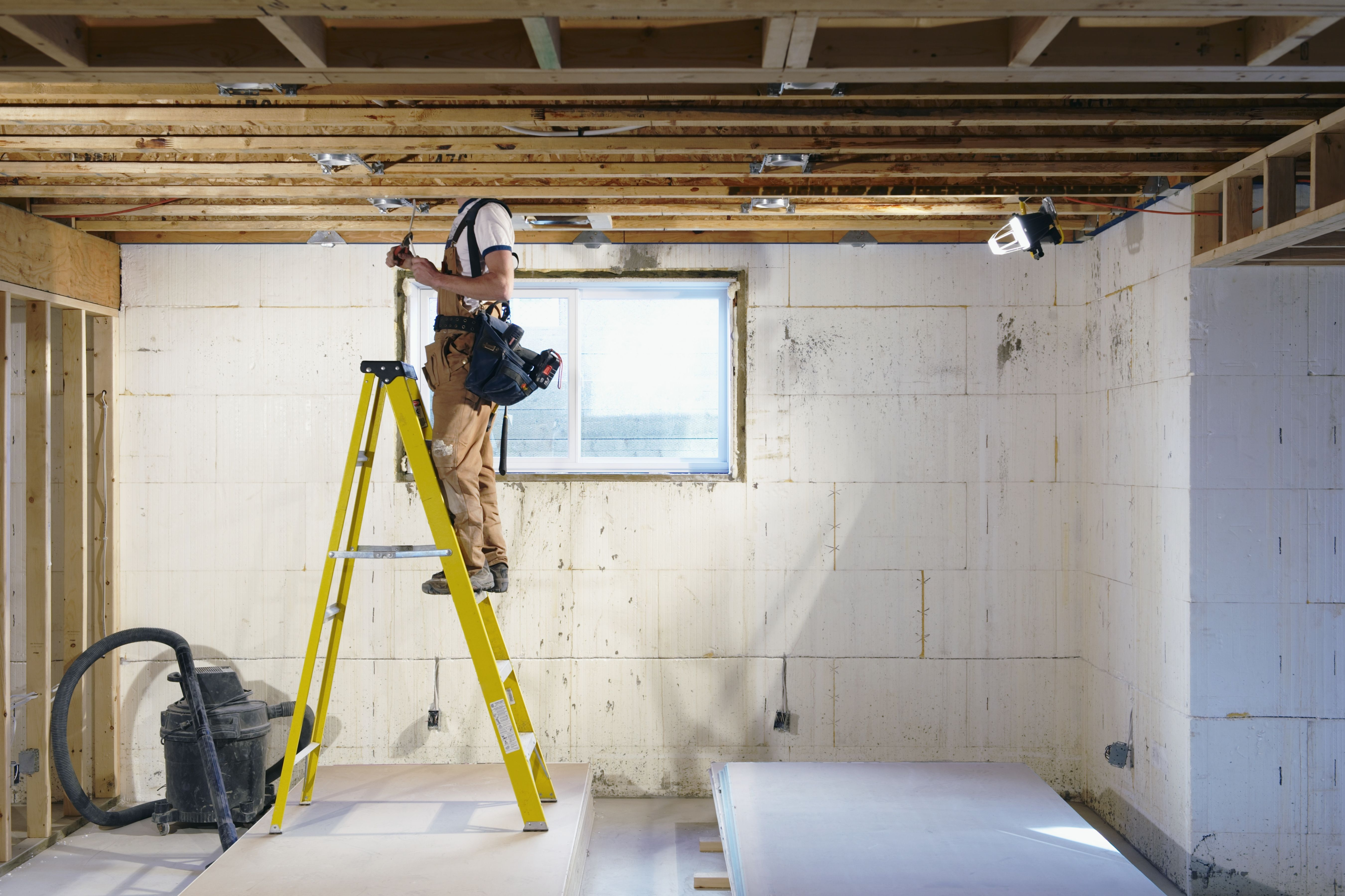 Man on ladder in new house