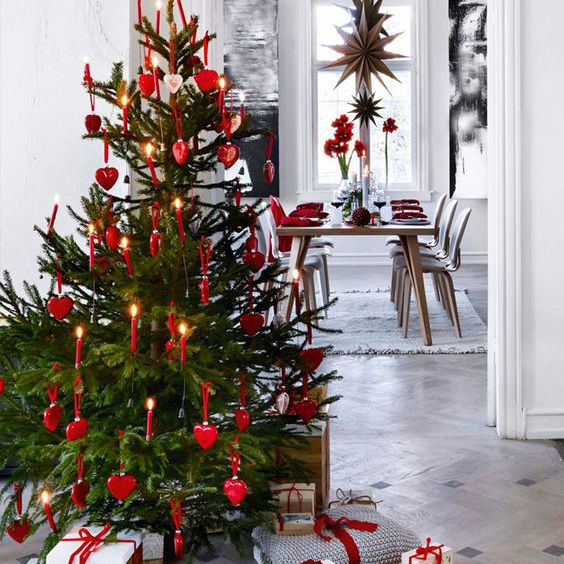 Scandinavian style Christmas tree decorated with red heart ornaments