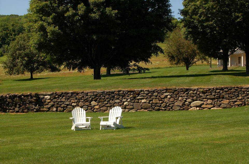 Image of chairs serving as focal point on big lawn.