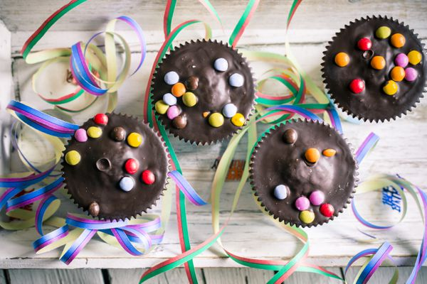 Cupcakes with chocolate icing and colorful candies
