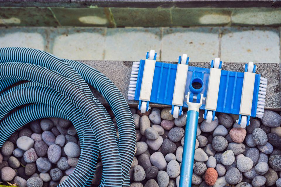 Pool vacuum at edge of pool