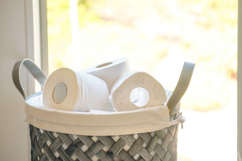 rolls of toilet paper in a basket