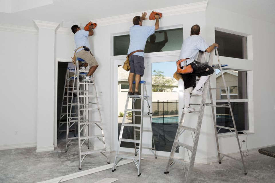 Workers Installing Crown Molding 168268191