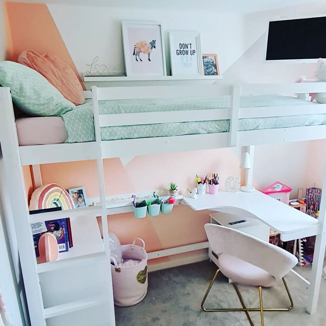 A loft bed for a little girl with a bed and TV at the top and a homework station on the bottom.