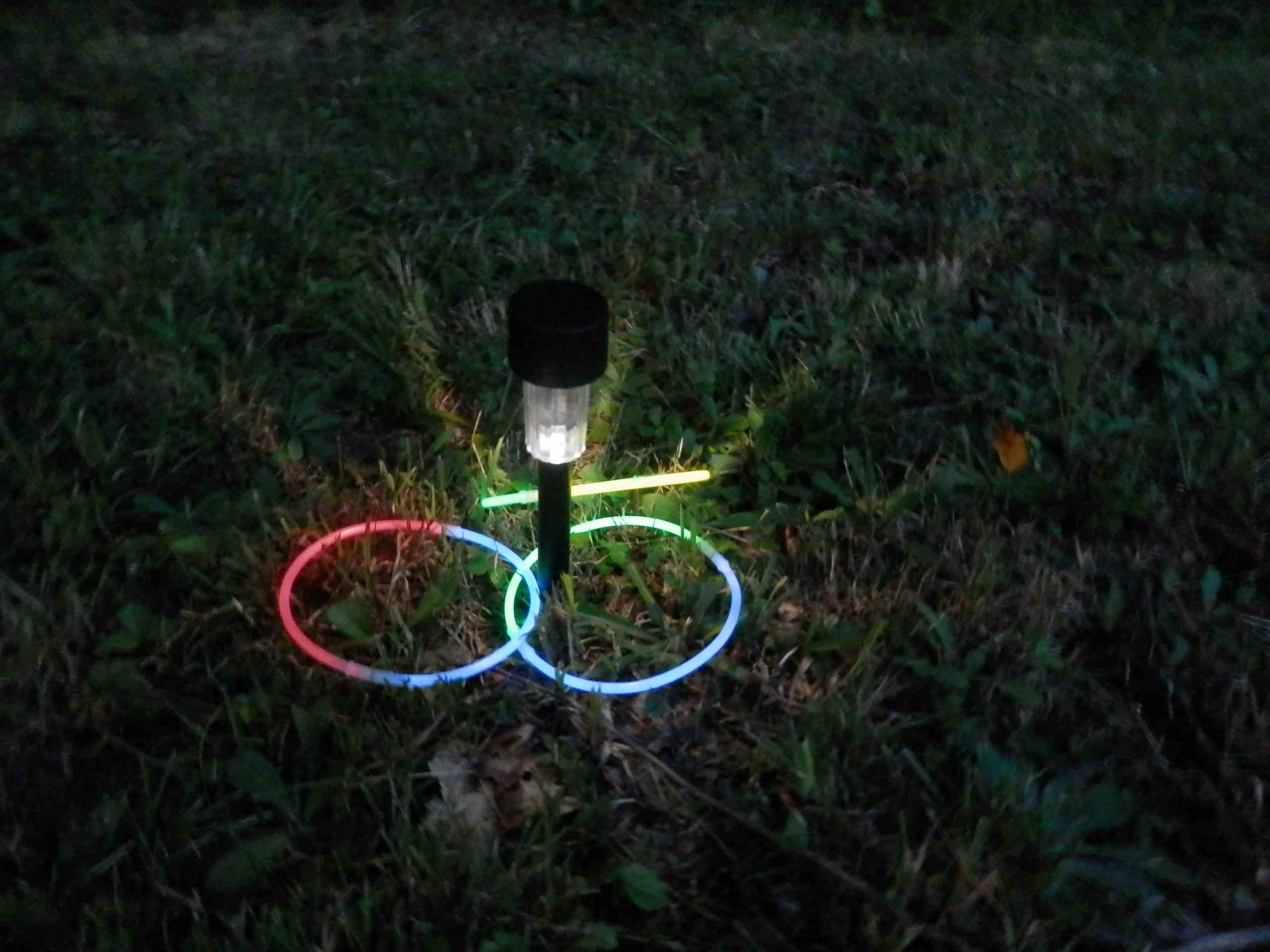 Ring toss game at nighttime.