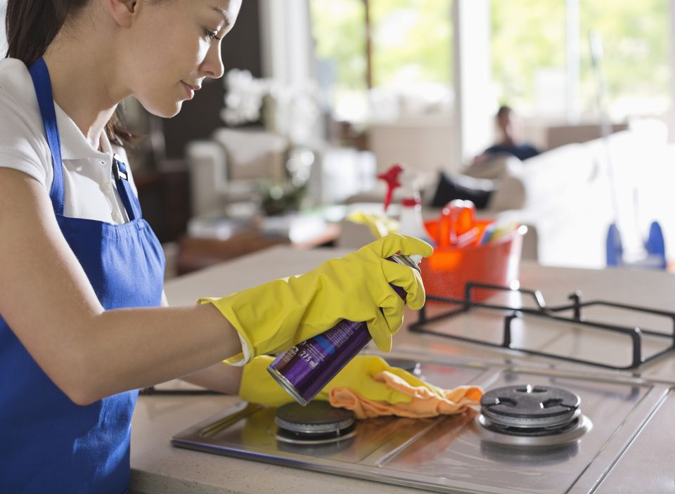Woman wearing dishwashing gloves during household cleaning
