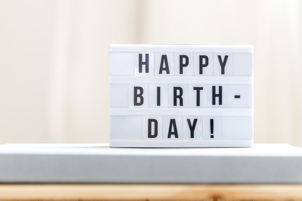 """A white letter board with black letters spelling out """"HAPPY BIRTHDAY!"""""""