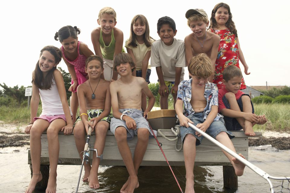 Children posed with fishing equipment