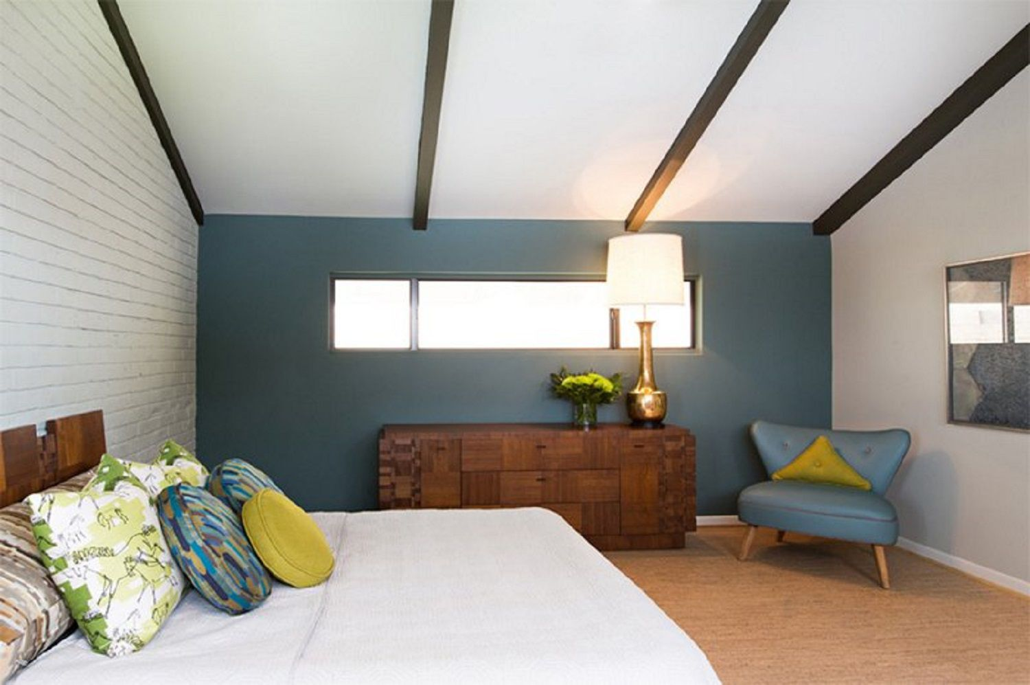 Blue accent wall in modern bedroom