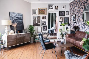 Oddly shaped living room with a gallery wall