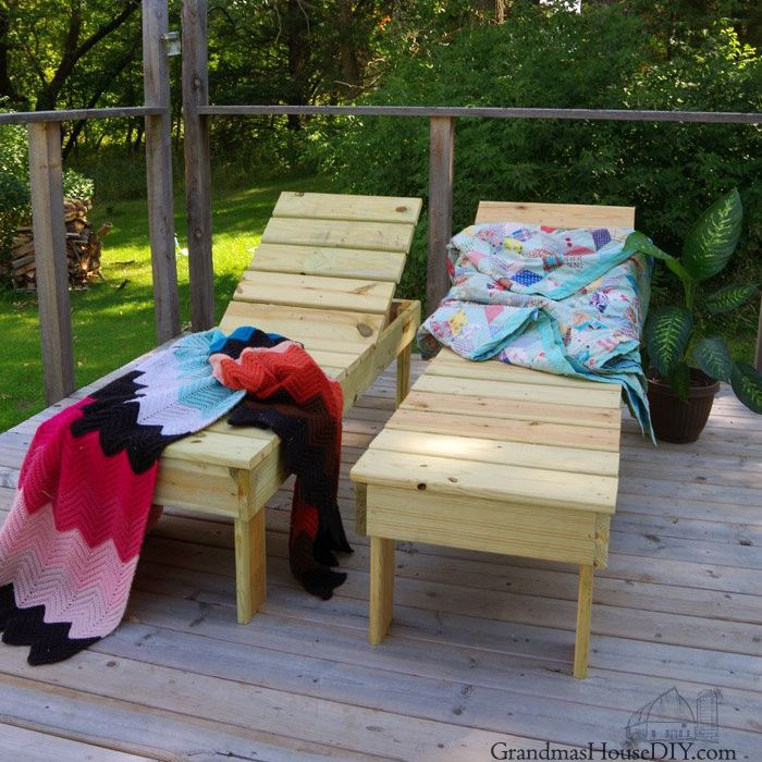 Two wooden chaise loungers on a deck