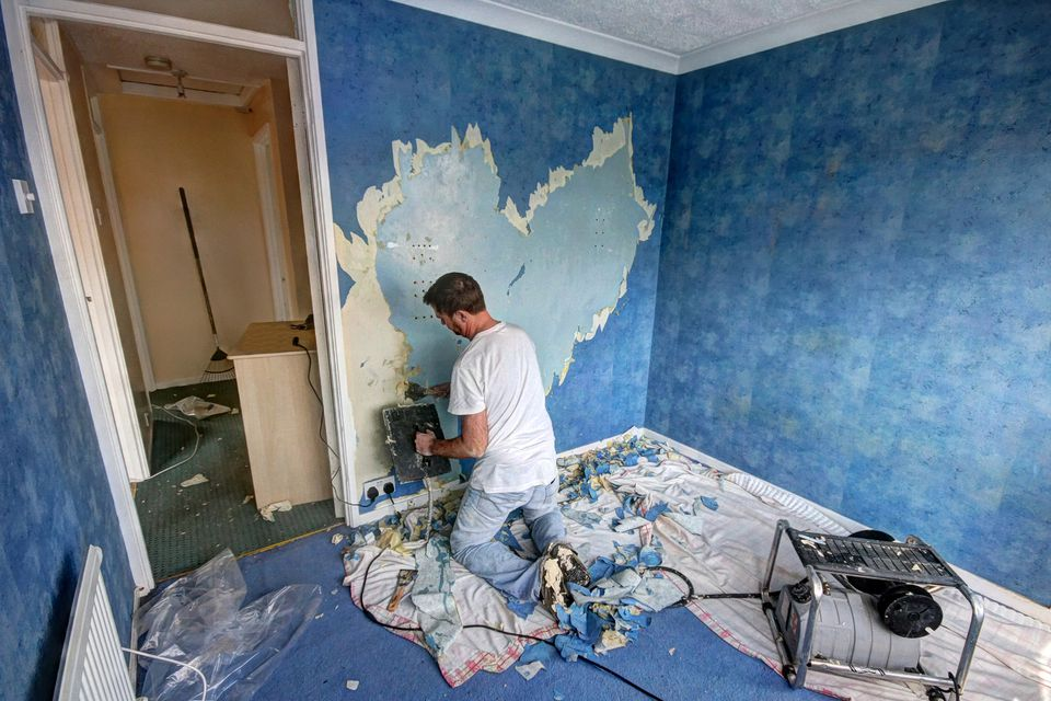 Removing Wallpaper Prior To Taking Down Wall