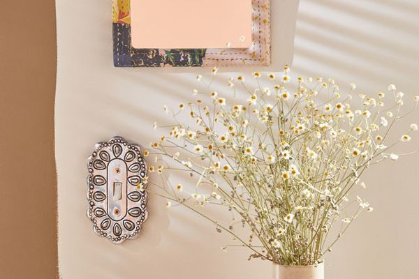 boho switch plate with mirror and flowers