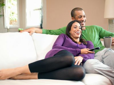 Couple relaxing and watching television