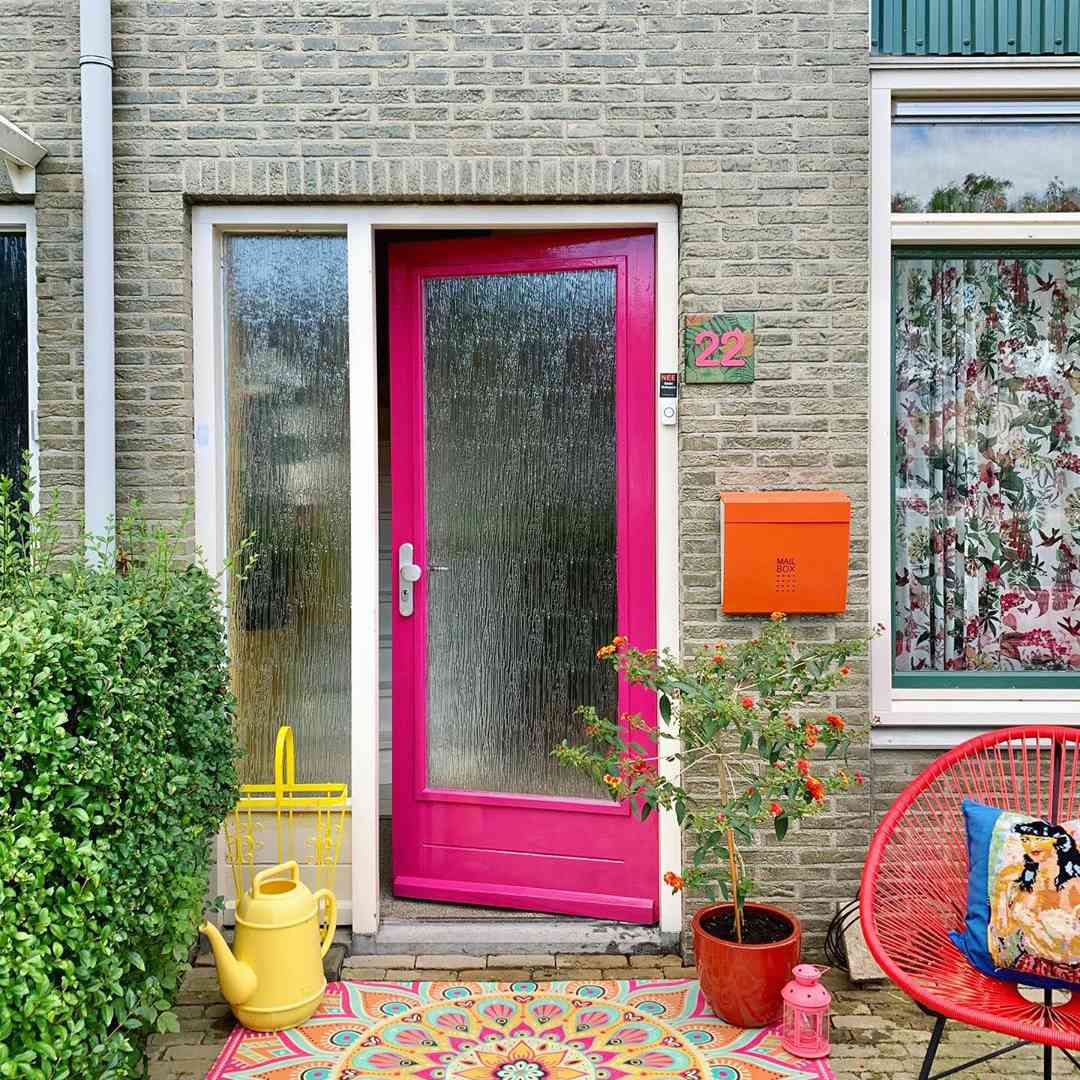 Glass front door with pink paint