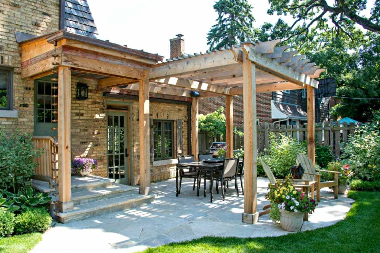 Pergola attached to brick home