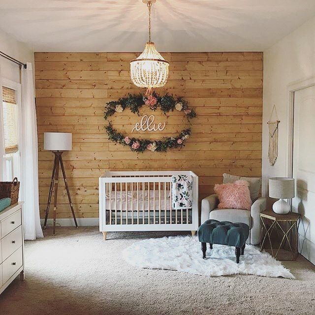 Boho girl nursery with rustic accent wall