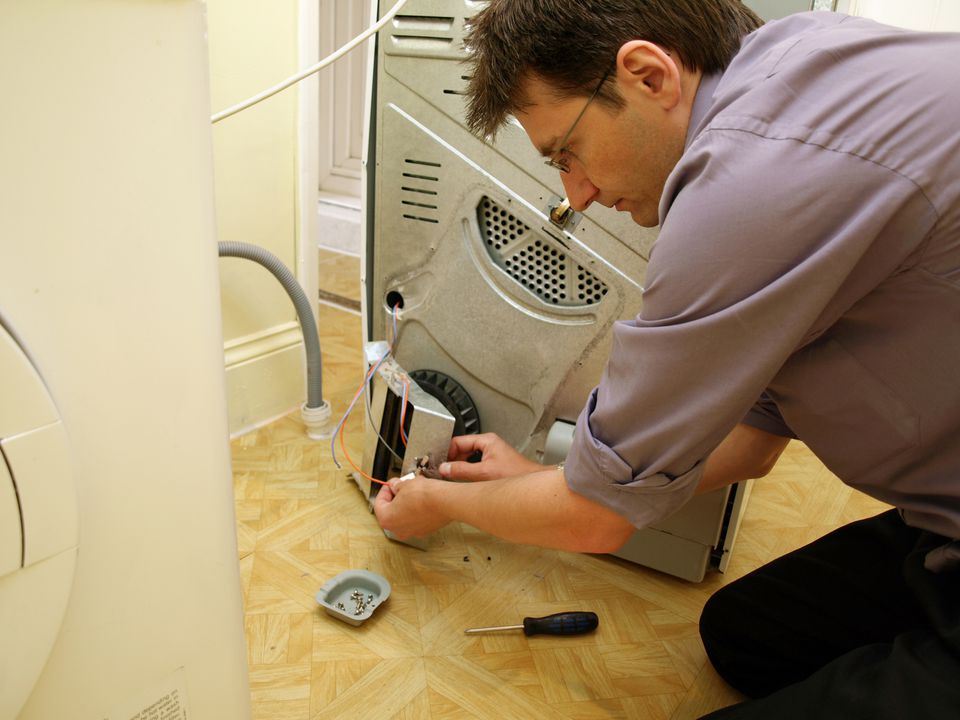 Man fixing clothes dryer