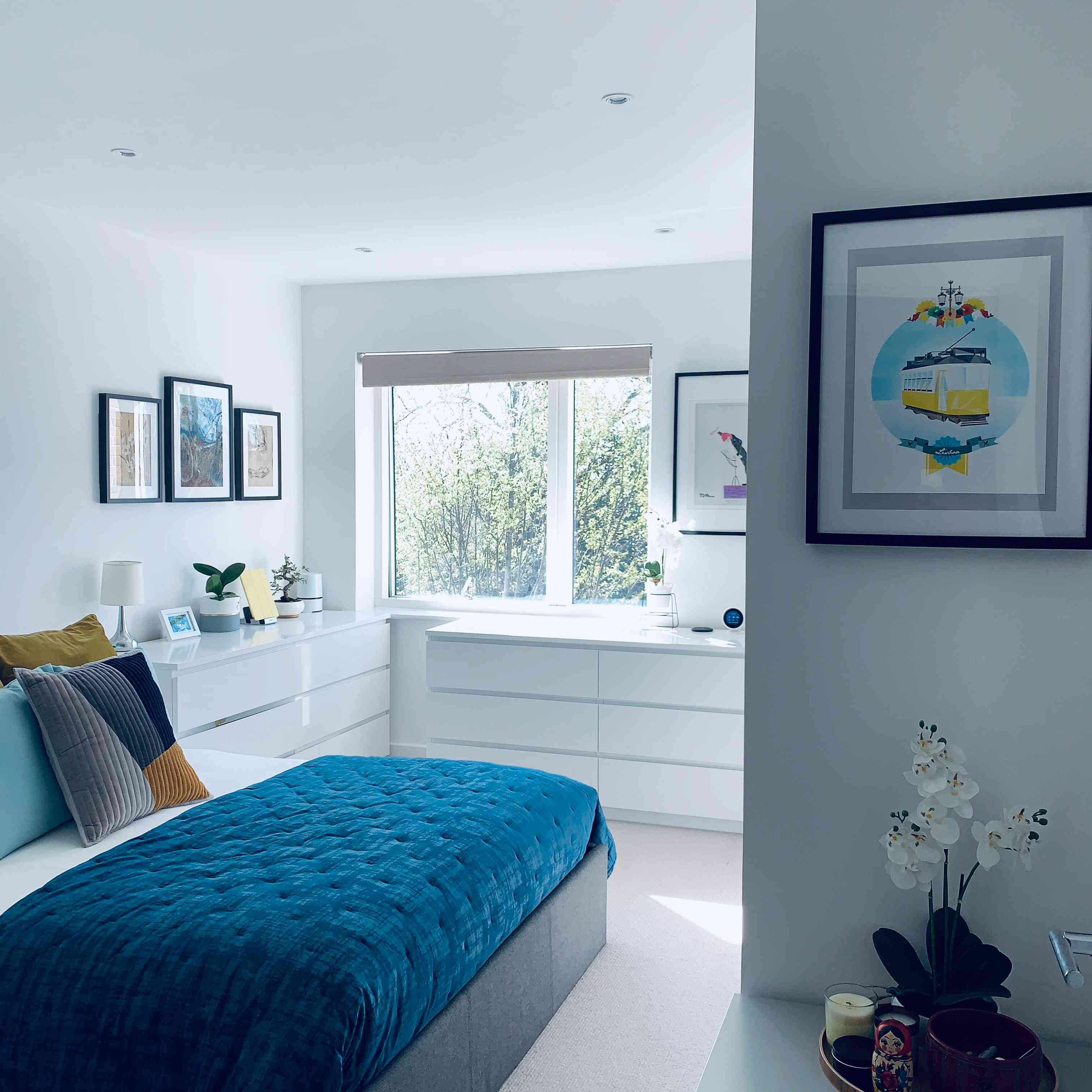 bedroom with white and blue colors