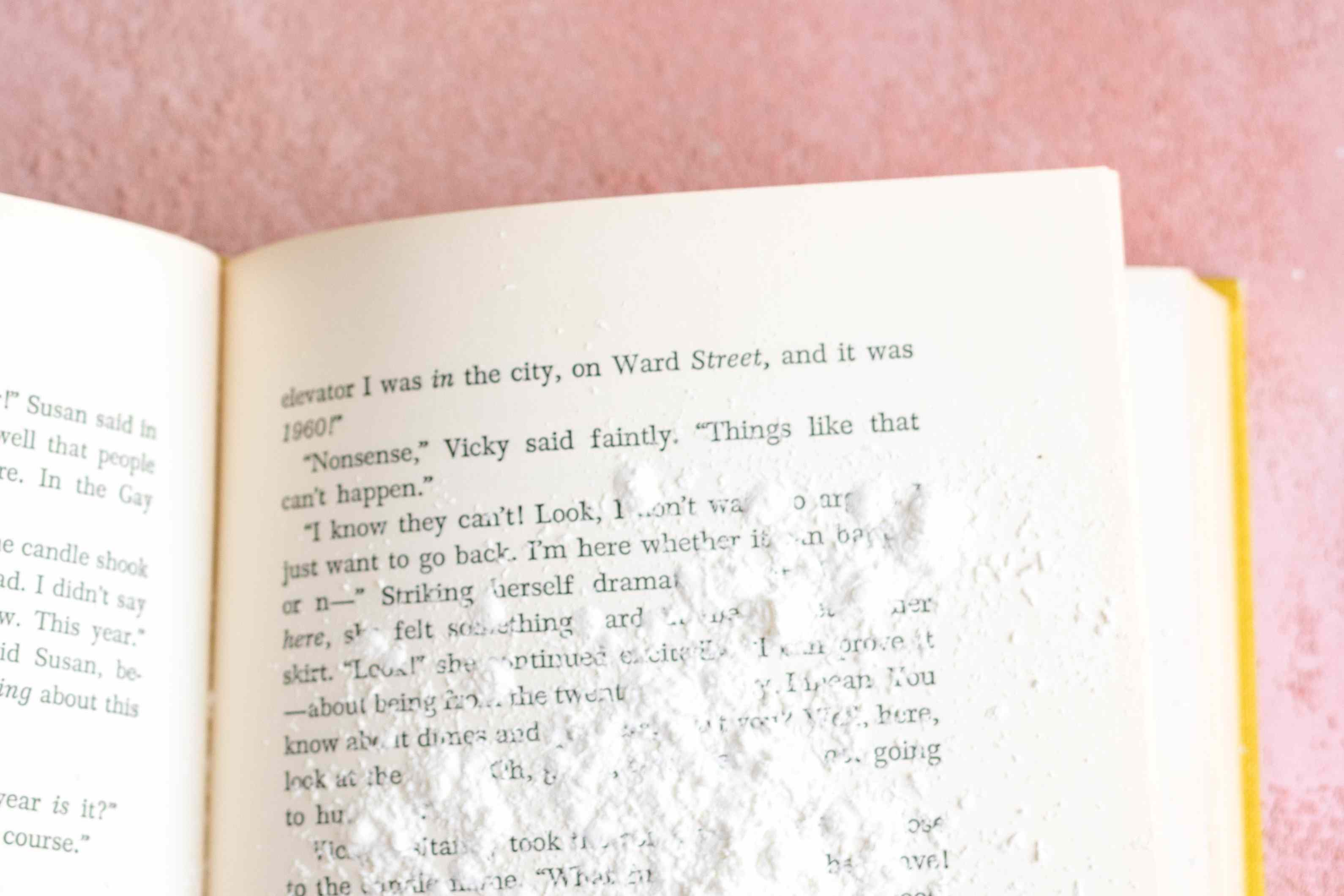 sprinkling cornstarch on book pages to absorb grease