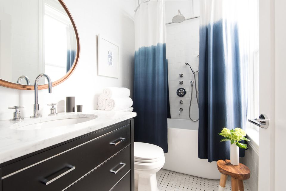 small shower with tiny tub indigo bathroom