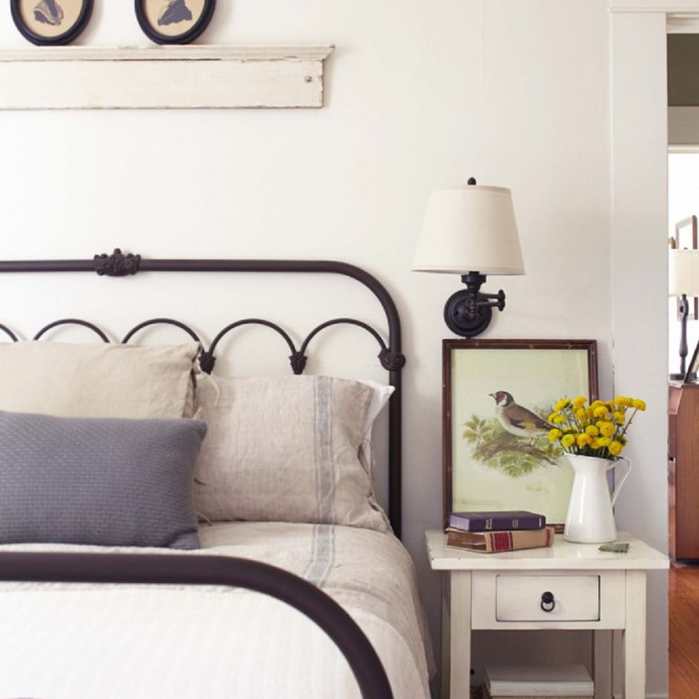 Farmhouse bedroom with metal bed