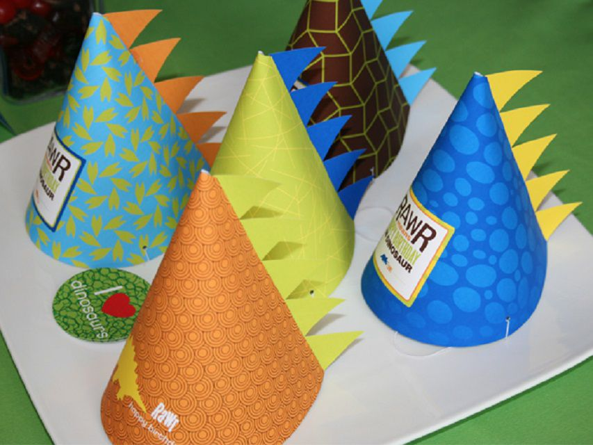 A group of dinosaur party hats