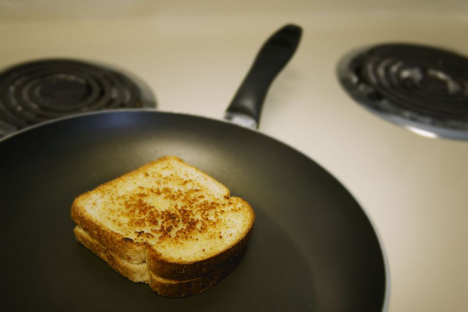 grilled cheese on a nonstick pan on a stove
