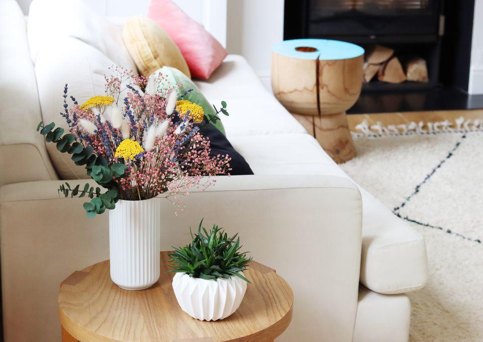 Dried flowers arranged in vase in living room