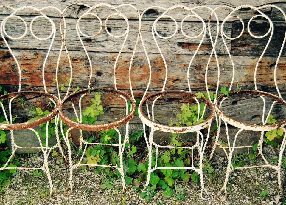 abandoned garden chairs