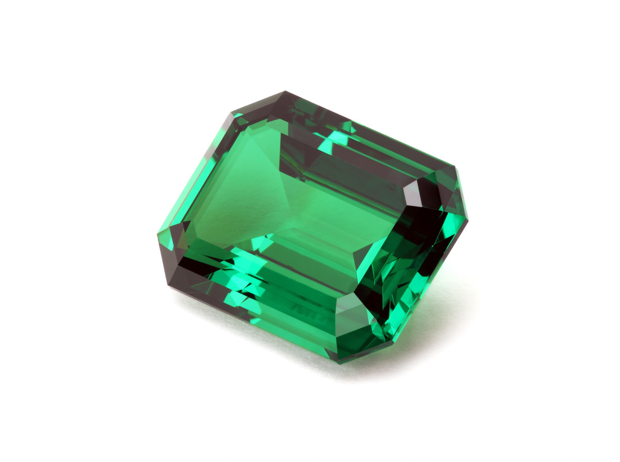 emerald gemstone on white background