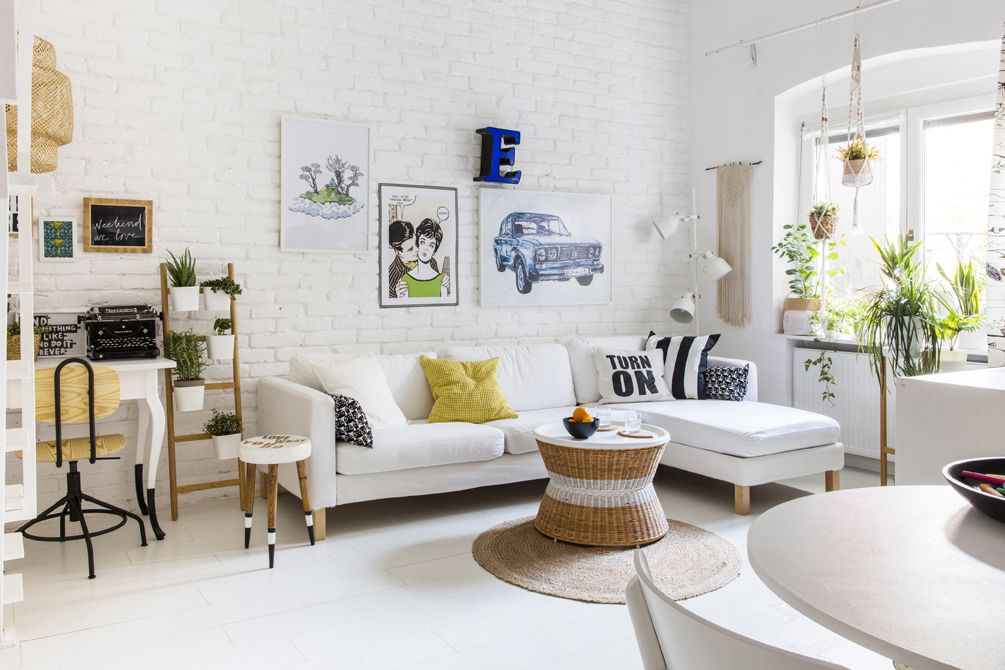 White room with white furniture and house plants