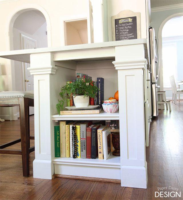 A built-in bookshelf on a kitchen island